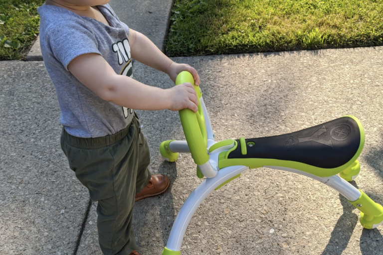 Cooper with assistive walking device
